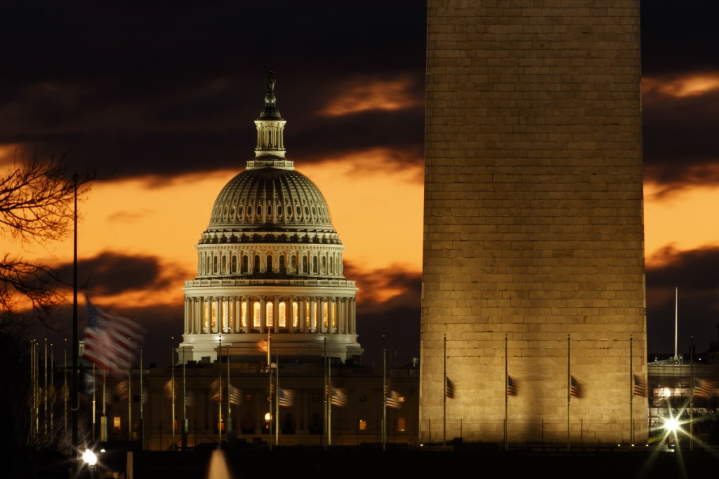 The U.S. Capitol dome is seen past the base of the Washington Monument just before sunrise in Washington, Saturday, Dec. 22, 2018. Hundreds of thousan...
