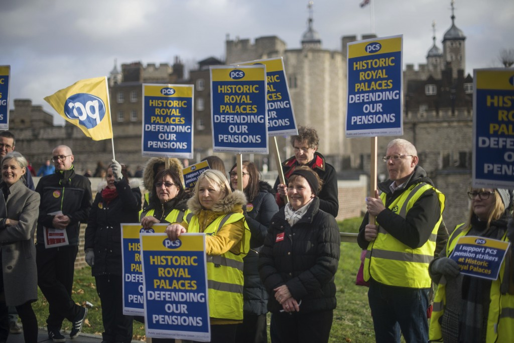 People at the Tower of London on the picket line as staff from Royal Palaces take industrial action over pay. Friday, Dec. 21, 2018. The strikers carr