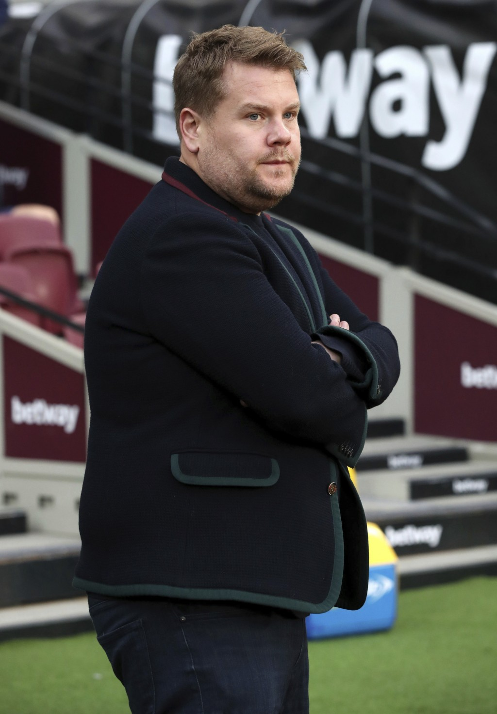 James Corden pitchside during the English Premier League soccer match between West Ham United and Watford at London Stadium in London, Saturday, Dec.
