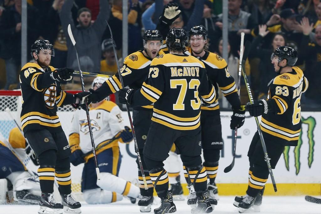 Boston Bruins' Patrice Bergeron (37) celebrates his goal with teammates Matt Grzelcyk (48), Charlie McAvoy (73), Brad Marchand (63) and Danton Heinen ...