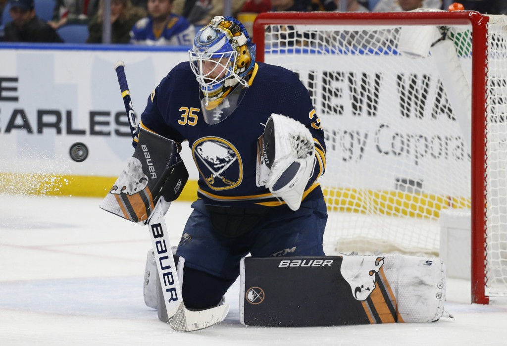 Buffalo Sabres goalie Linus Ullmark (35) makes a save during the second period of an NHL hockey game against the Anaheim Ducks, Saturday, Dec. 22, 201...