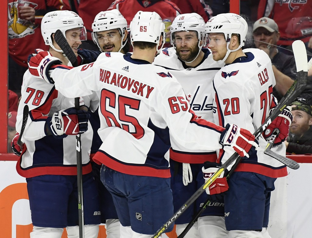 Washington Capitals right wing Brett Connolly (10) celebrates his goal against the Ottawa Senators with teammates during the first period of an NHL ho...