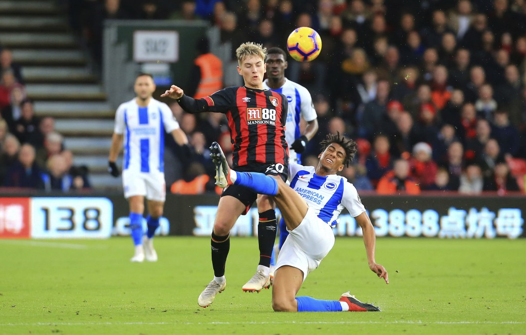Bournemouth's David Brooks, left, and Brighton & Hove Albion's Bernardo battle for the ball during the English Premier League soccer match between AFC...