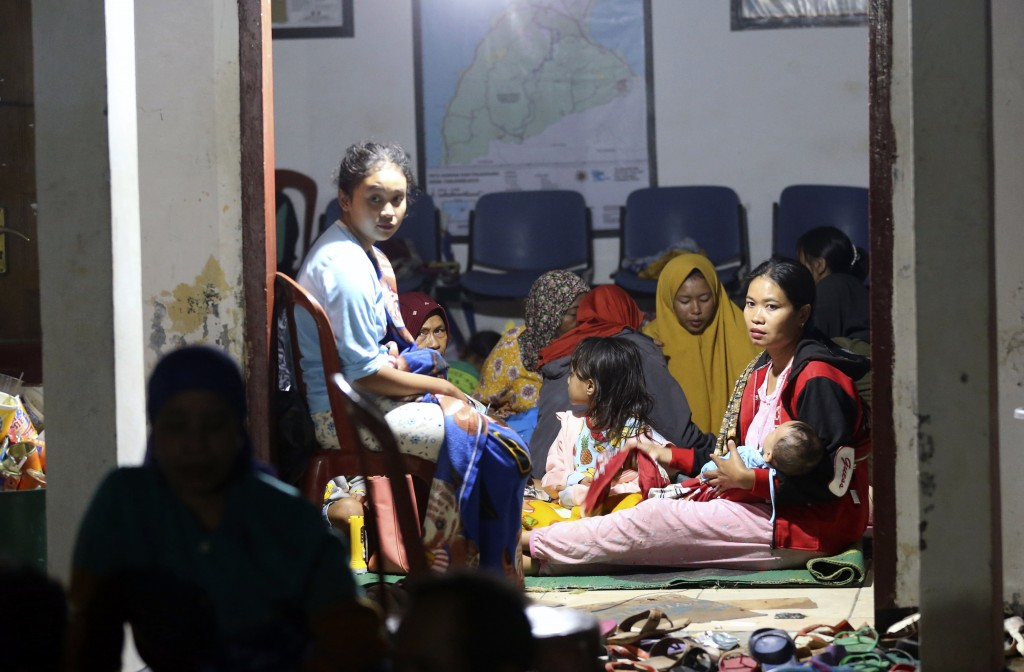 Tsunami survivors gather at temporary shelter in Tanjung Lesung, Indonesia, Sunday, Dec. 23, 2018. The tsunami occurred after the eruption of a volcan...