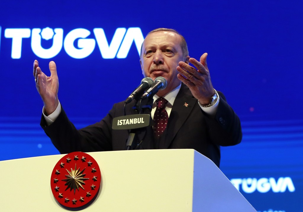 Turkey's President Recep Tayyip Erdogan addresses a meeting of a youth organisation founded by his elder son Bilal Erdogan and his friends, in Istanbu...
