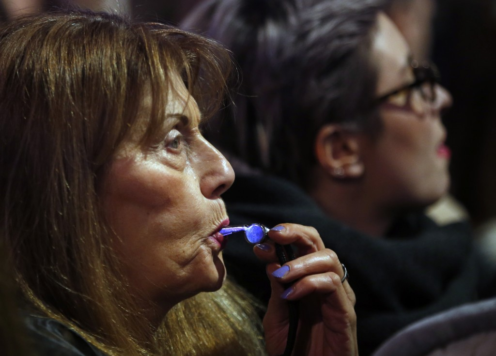 A woman blows whistle during a protest against populist President Aleksandar Vucic in Belgrade, Serbia, Saturday, Dec. 22, 2018. Thousands of people h