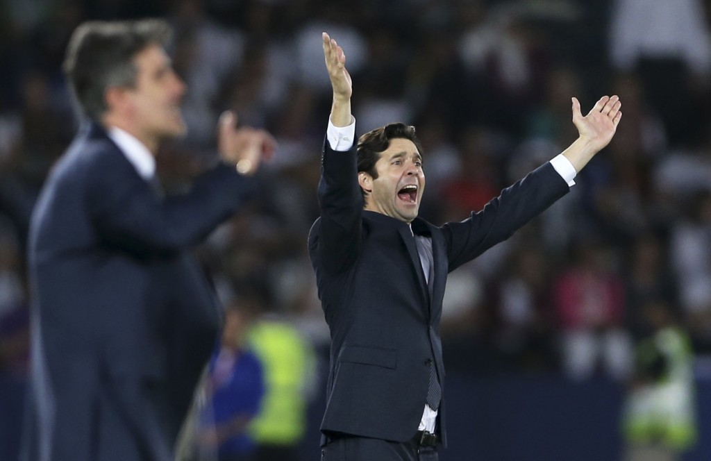 Real Madrid's coach Santiago Solari and Emirates's Al Ain head coach Zoran Mamic, left, gesture during the Club World Cup final soccer match between R...