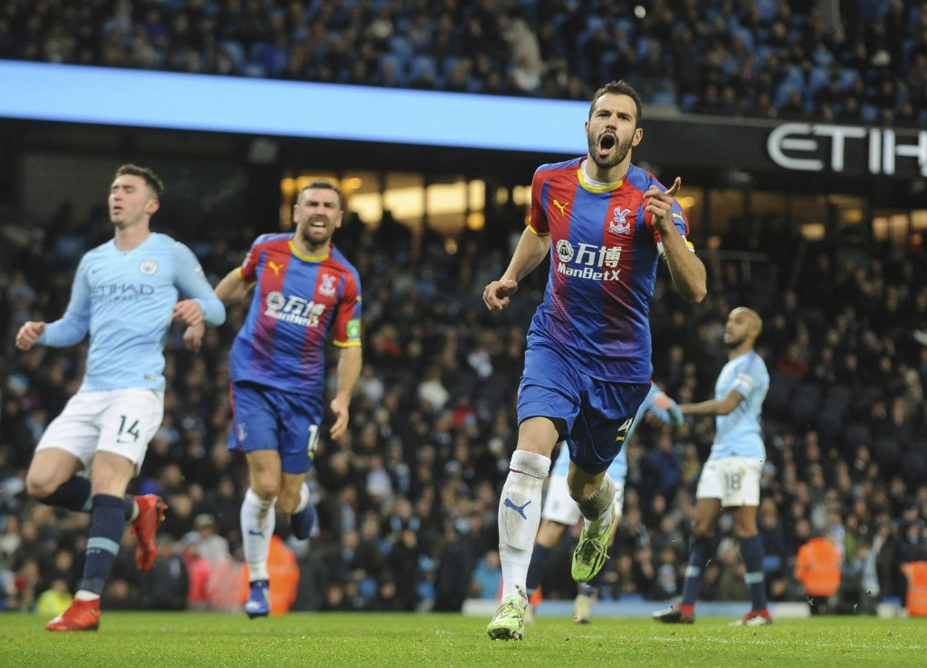 Crystal Palace's Luka Milivojevic celebrates with his teammates after scoring his side's third goal during the English Premier League soccer match bet...
