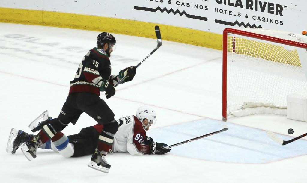 Arizona Coyotes center Brad Richardson (15) scores an empty net goal as Colorado Avalanche left wing Gabriel Landeskog (92) is unable to stop the puck...