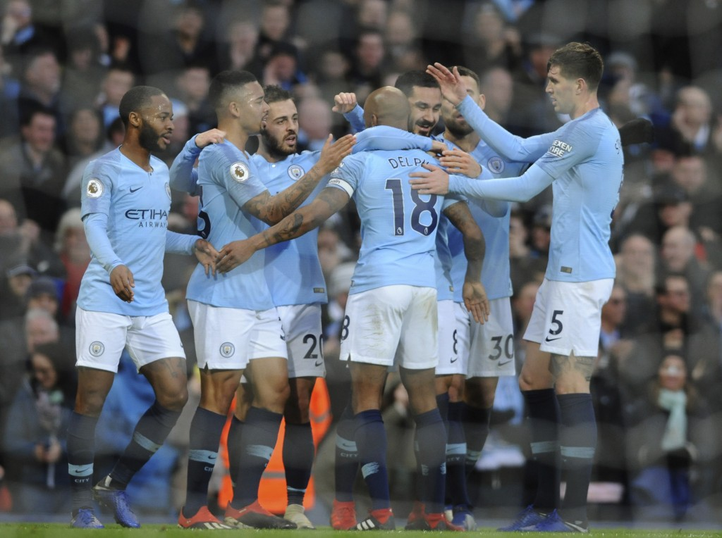 Manchester City players celebrate after Manchester City's Ilkay Gundogan scored his side's opening goal during the English Premier League soccer match...