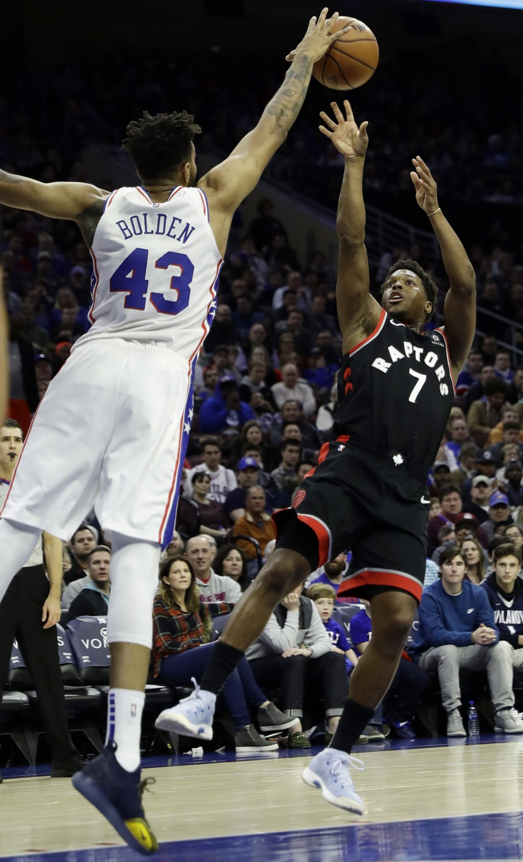 Toronto Raptors' Kyle Lowry, right, cannot get a shot past Philadelphia 76ers' Jonah Bolden during the first half of an NBA basketball game, Saturday,