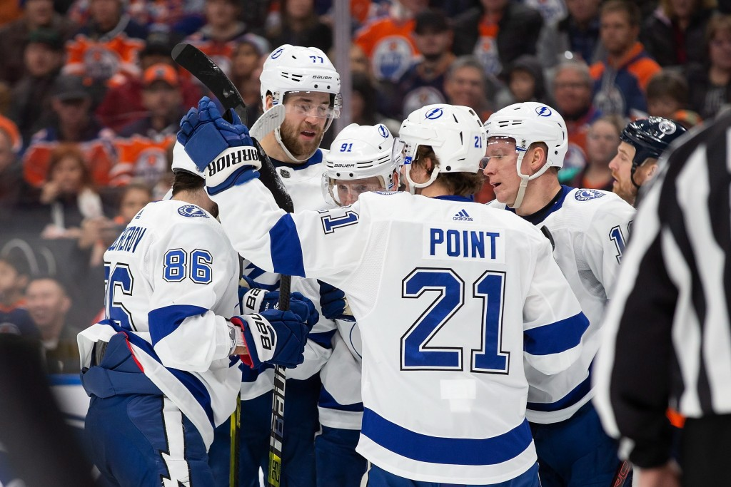 Tampa Bay Lightning players celebrate a goal against the Edmonton Oilers during the first period of an NHL hockey game Saturday, Dec. 22, 2018, in Edm...