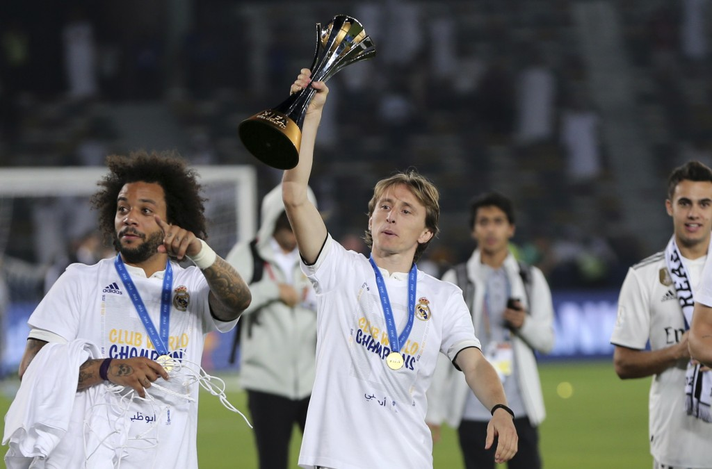 Real Madrid's Luka Modric holds the trophy after winning the Club World Cup final soccer match between Real Madrid and Al Ain at Zayed Sport City in A...