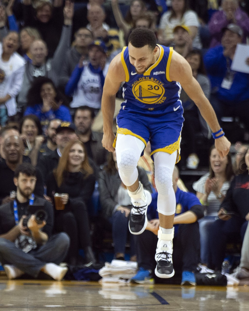 Golden State Warriors' Stephen Curry celebrates a 3-point basket against the Dallas Mavericks during the second quarter of an NBA basketball game Satu...