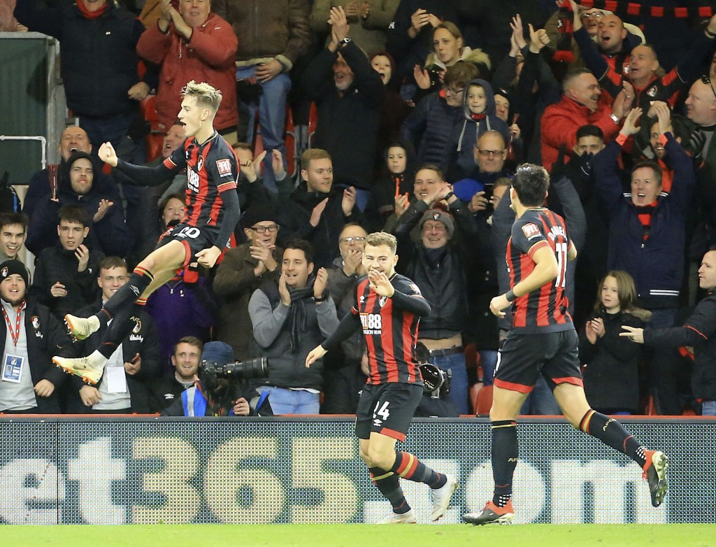Bournemouth's David Brooks, left celebrates scoring his side's second goal of the game during the English Premier League soccer match between AFC Bour...