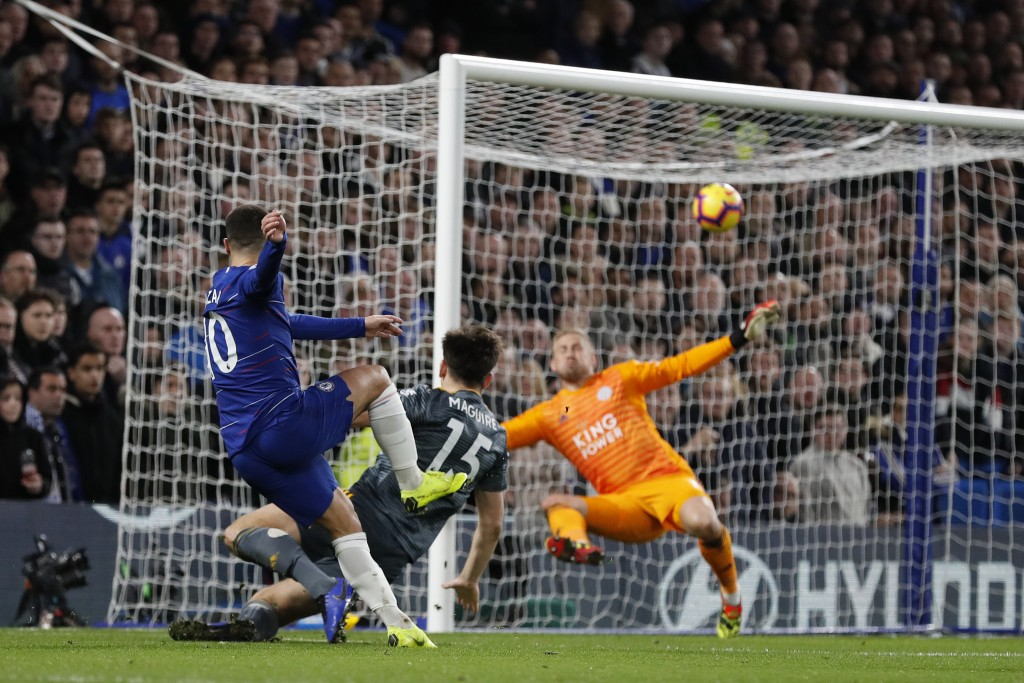 Chelsea's Eden Hazard shots the ball in a failed attempt to score during the English Premier League soccer match between Chelsea and Leicester City at...