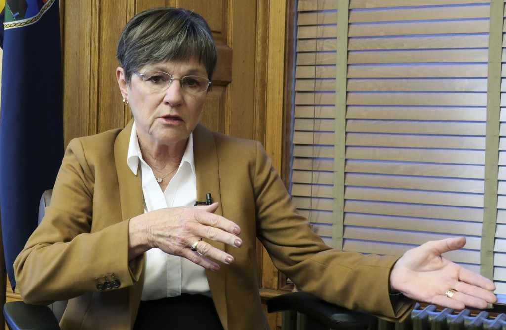 In this Dec. 17, 2018 photo, Kansas Gov.-elect Laura Kelly answers questions during an interview with The Associated Press, at the Statehouse in Topek