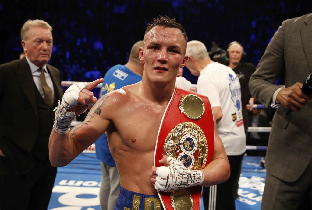 Josh Warrington celebrates after defeating Carl Frampton during their IBF featherweight title boxing bout Saturday, Dec. 22, 2018, in Manchester, Engl...