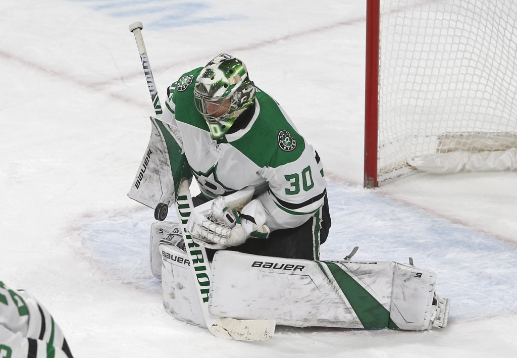 Dallas Stars goalie Ben Bishop stops a Minnesota Wild shot in the second period of an NHL hockey game Saturday, Dec. 22, 2018, in St. Paul, Minn. (AP