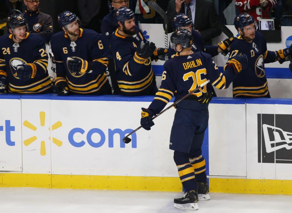 Buffalo Sabres defenseman Rasmus Dahlin (26) celebrates his goal during the first period of an NHL hockey game against Anaheim Ducks, Saturday, Dec. 2...