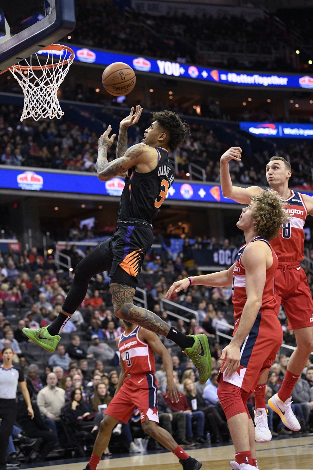 Phoenix Suns forward Kelly Oubre Jr. (3) loses the ball as Washington Wizards forward Sam Dekker (8), guard Ron Baker (84) and guard Chasson Randle (9...