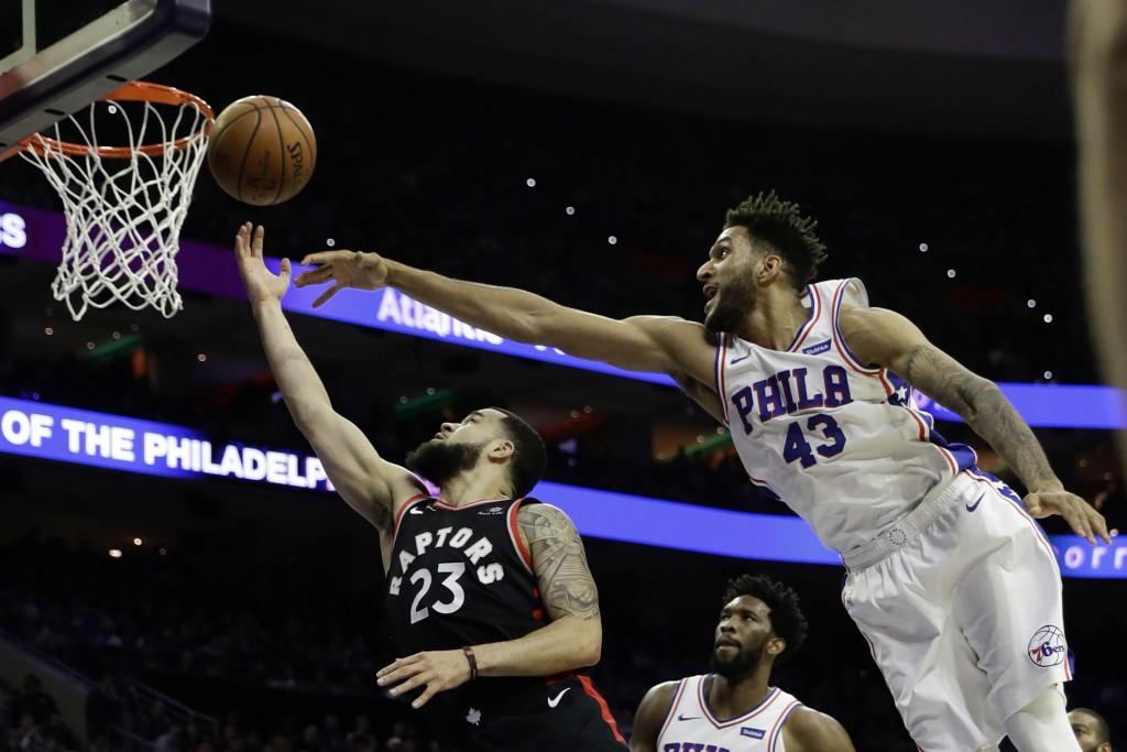 Toronto Raptors' Fred VanVleet (23) goes up for a shot against Philadelphia 76ers' Jonah Bolden (43) during the first half of an NBA basketball game,