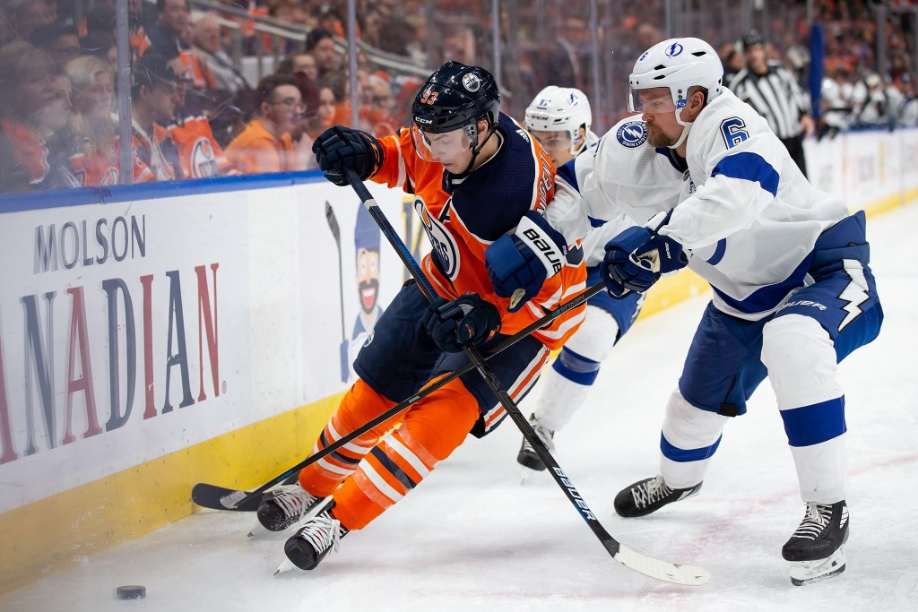 Edmonton Oilers center Ryan Nugent-Hopkins (93) and Tampa Bay Lightning defenseman Anton Stralman (6) vie for the puck during the second period of an ...