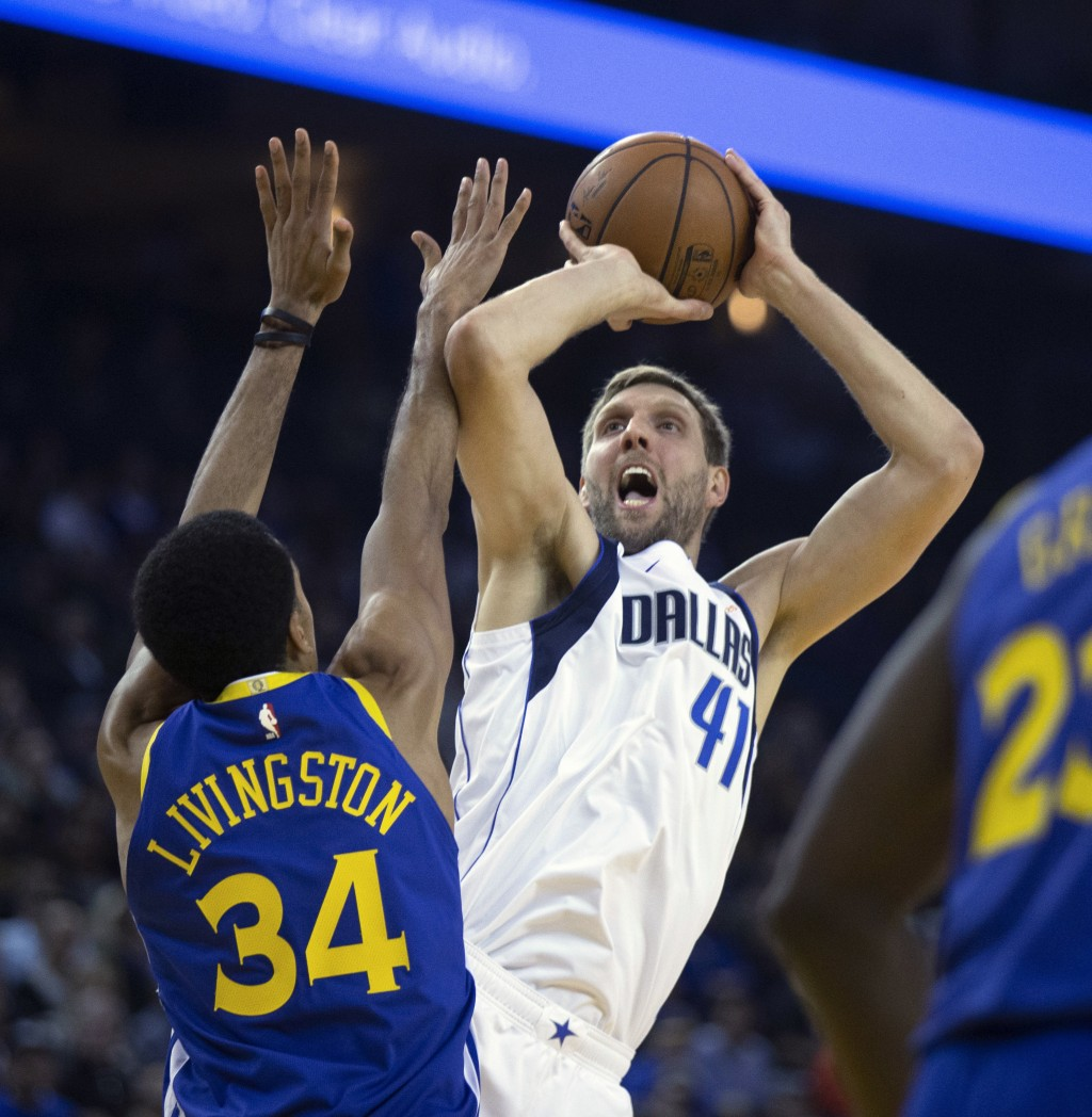 Dallas Mavericks' Dirk Nowitzki shoots over Golden State Warriors' Shaun Livingston during the second quarter of an NBA basketball game Saturday, Dec....