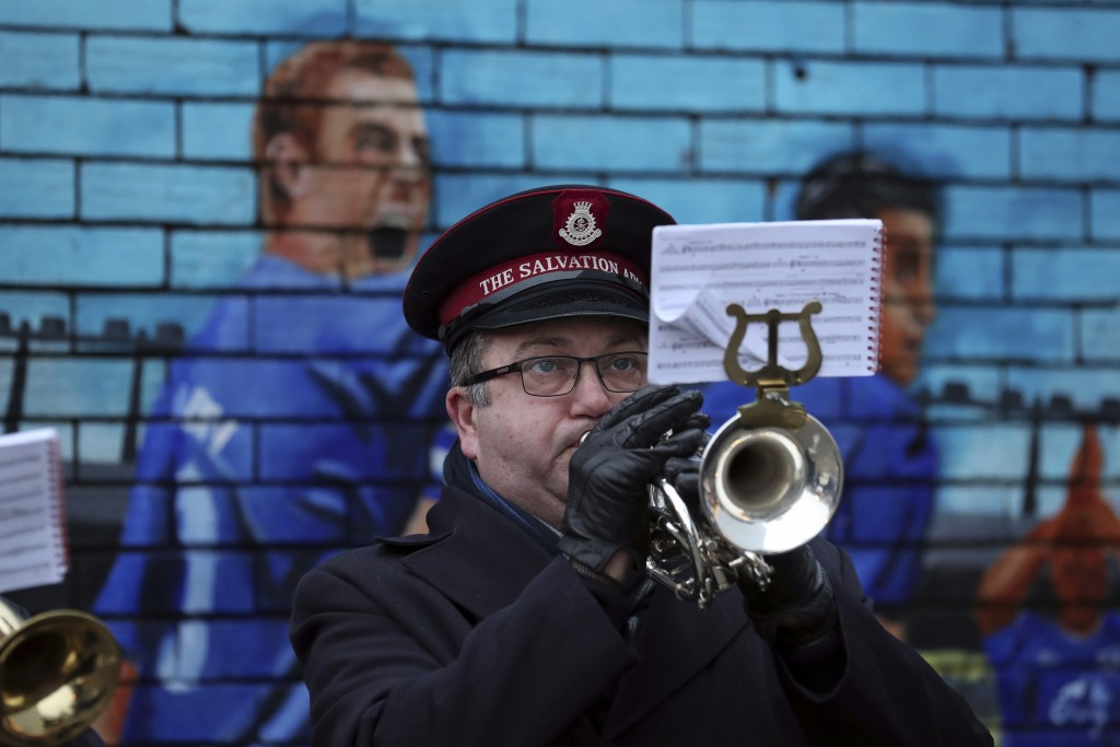 A member of the Salvation Army brass band plays Christmas Carols outside the Goodison Park Stadium prior to the start of the English Premier League so