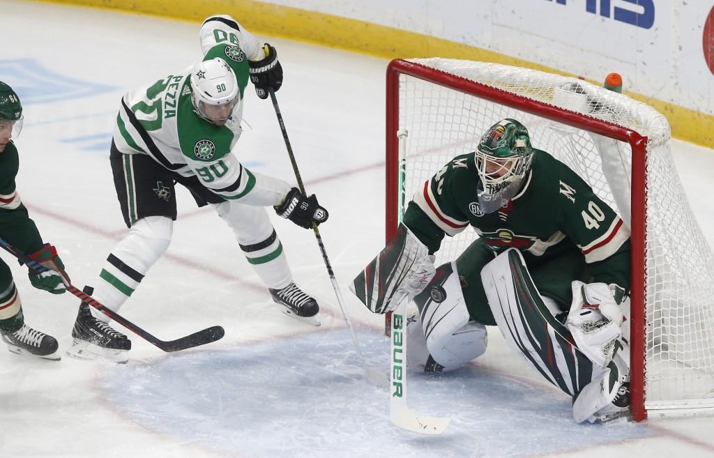 Minnesota Wild goalie Devan Dubnyk, right, stops a shot by Dallas Stars' Jason Spezza in the first period of an NHL hockey game Saturday, Dec. 22, 201