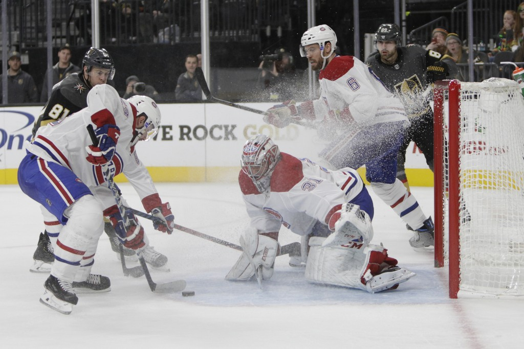 Montreal Canadiens goaltender Carey Price (31) makes a save during the second period of an NHL hockey game against the Vegas Golden Knights, Saturday,...