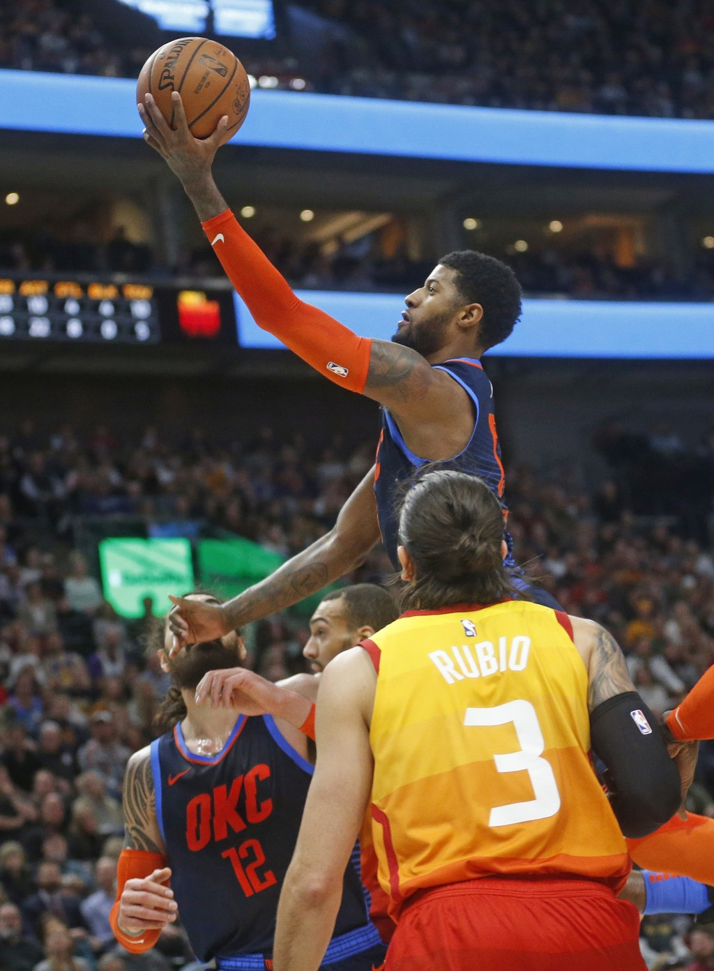 Oklahoma City Thunder forward Paul George goes to the basket as Utah Jazz guard Ricky Rubio (3) looks on in the first half of an NBA basketball game, ...