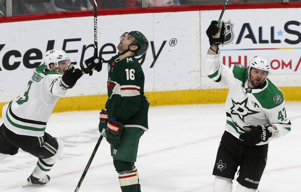 Dallas Stars' Alexander Radulov, right, of Russia, and John Klingberg, left, of Sweden, celebrate Radulov's game-winning goal in overtime as Minnesota...