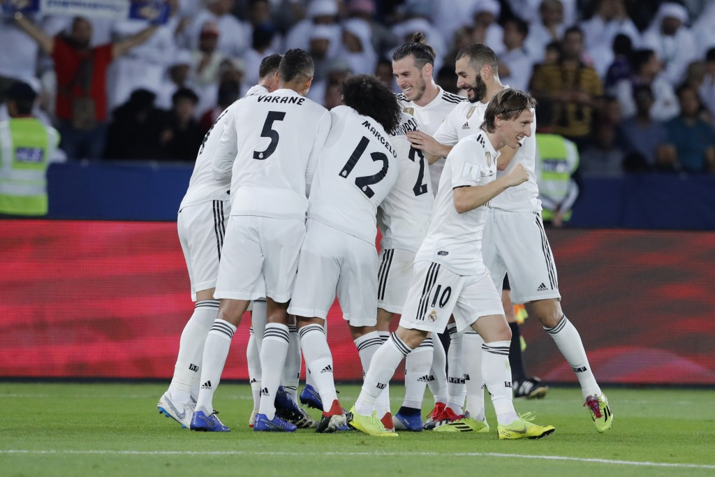 Real Madrid's players celebrate after scoring during the Club World Cup final soccer match between Real Madrid and Al Ain at Zayed Sport City in Abu D