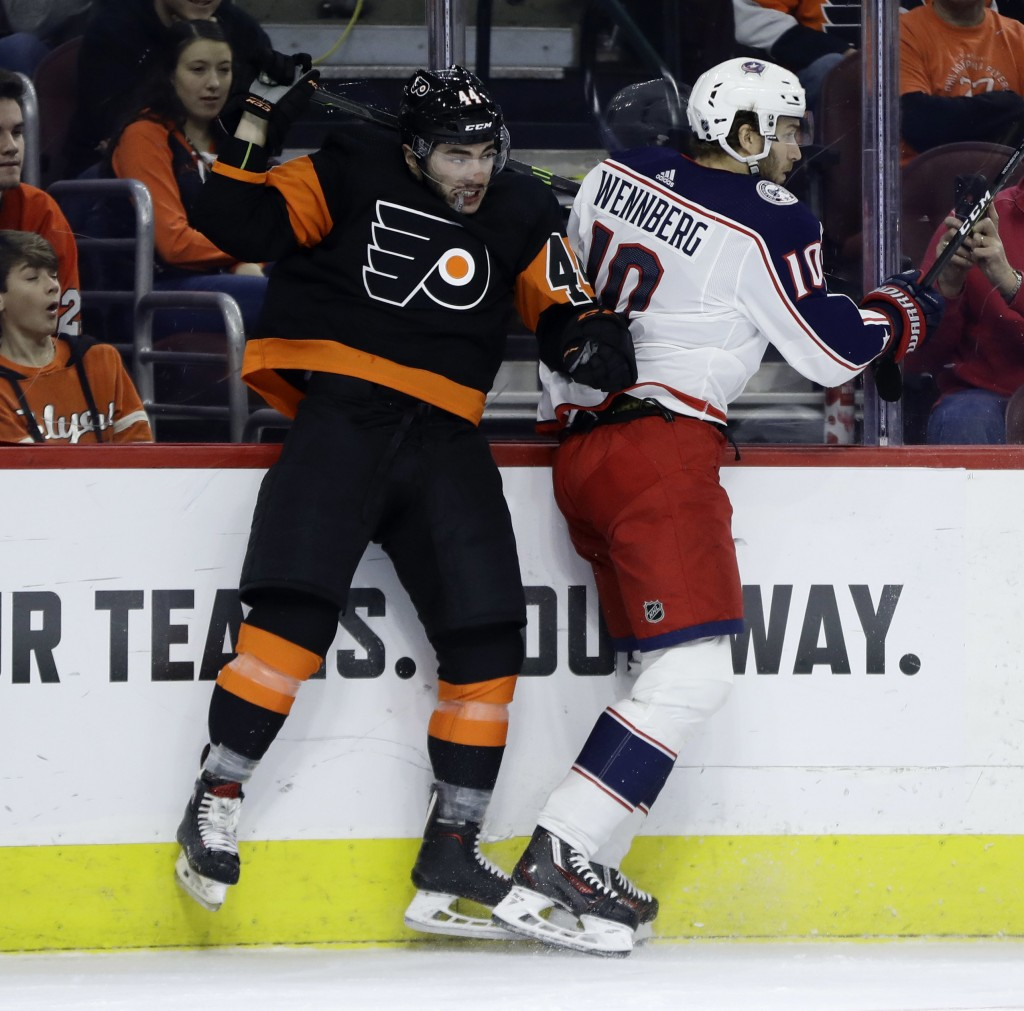 Philadelphia Flyers' Phil Varone (44) collides with Columbus Blue Jackets' Alexander Wennberg (10) during the first period of an NHL hockey game, Satu