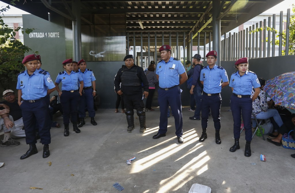 In this Dec. 17, 2018 photo, National Police officers stand guard outside the court building in Managua, Nicaragua. Heavy-handed raids on the country'