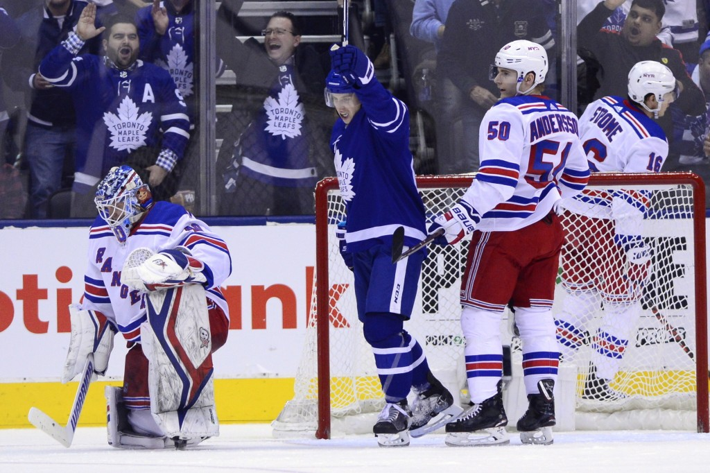 Toronto Maple Leafs right wing Mitchell Marner (16) celebrates Morgan Rielly's goal against New York Rangers goaltender Alexandar Georgiev (40) during