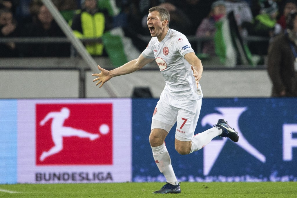Duesseldorf's Oliver Fink celebrates after scoring the opening goal during the German Bundesliga soccer match between Hannover 96 and Fortuna Duesseld