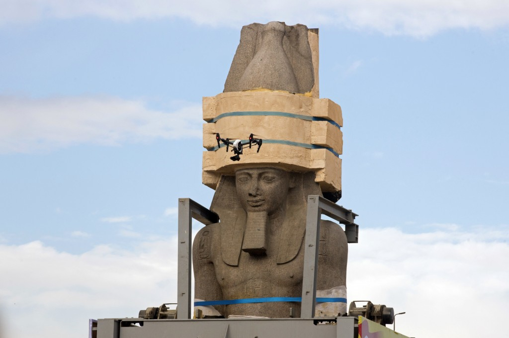 FILE - In this Jan. 25, 2018 file photo, a drone flies around a giant statue of the pharaoh Ramses II as it is relocated to the Grand Egyptian Museum,...