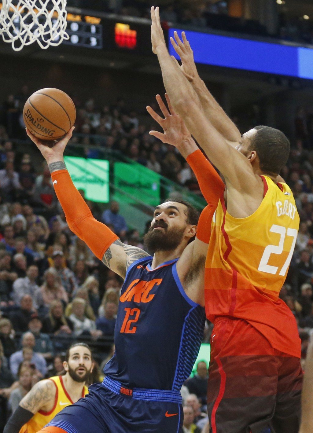 Oklahoma City Thunder center Steven Adams (12) goes to the basket as Utah Jazz center Rudy Gobert (27) defends in the first half of an NBA basketball ...