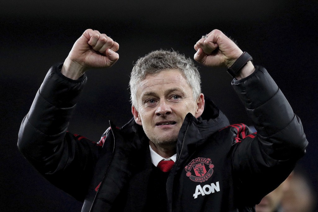Manchester United manager Ole Gunnar Solskjaer celebrates his win against Cardiff City after the English Premier League match between Cardiff City and...