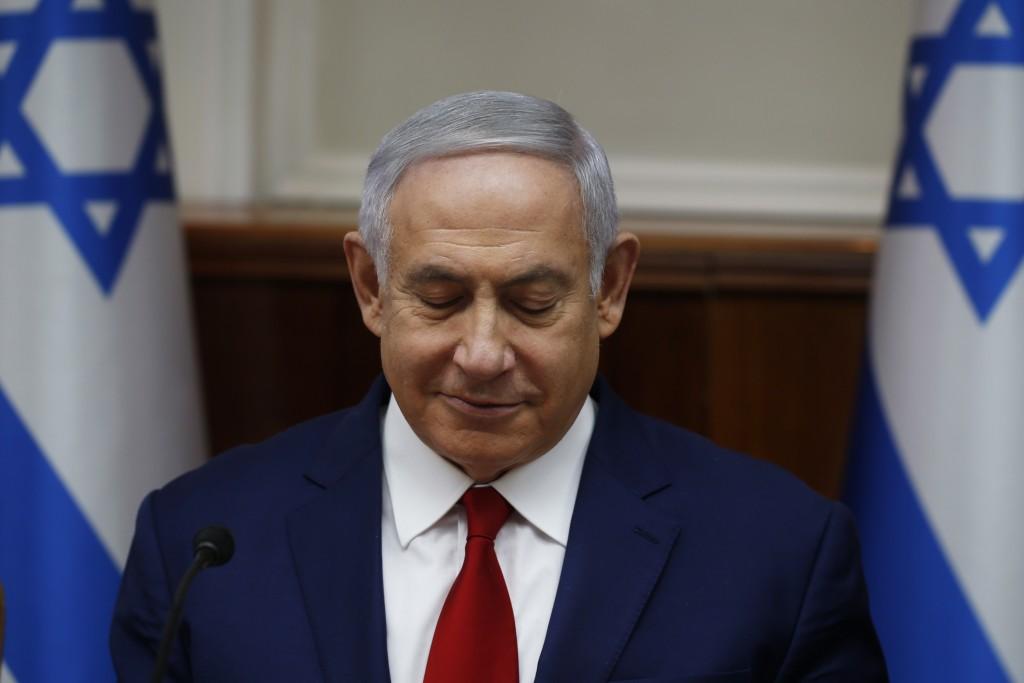Israeli Prime Minister Benjamin Netanyahu chairs the weekly cabinet meeting in Jerusalem Sunday, Dec. 23, 2018. (Ronen Zvulun/Pool via AP)