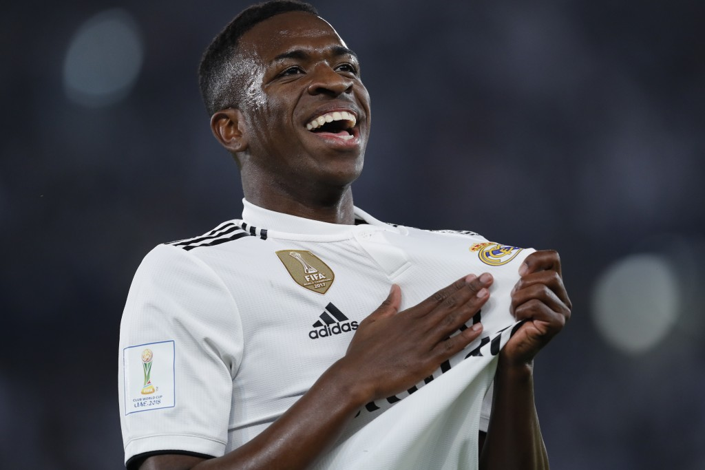 Real Madrid's forward Vinicius Junior celebrates his side's fourth goal after Emirates's Al Ain Yahia Nader's own goal during the Club World Cup final...