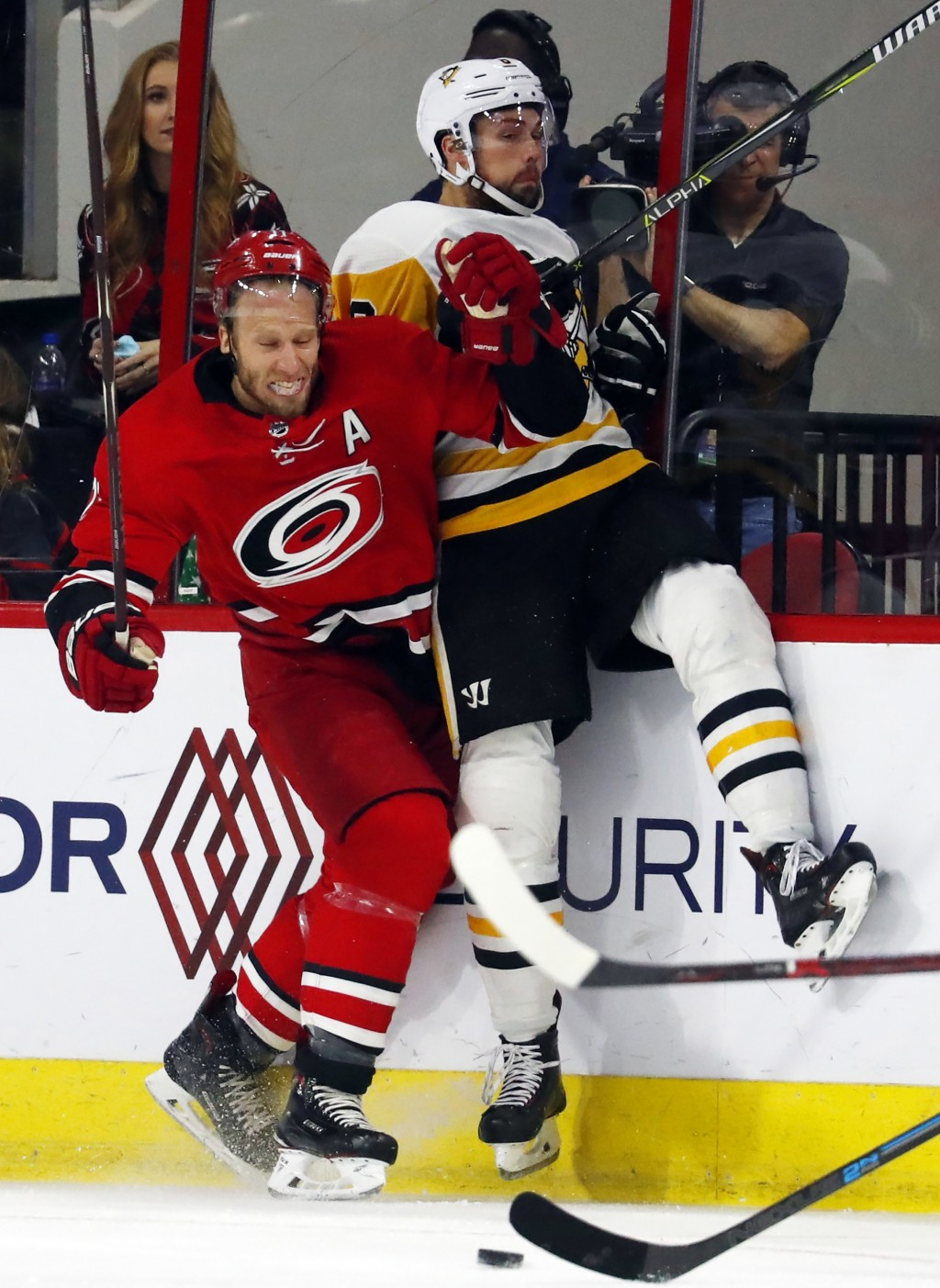 Carolina Hurricanes' Jordan Staal, left, collides with Pittsburgh Penguins' Brian Dumoulin, right, during the first period of an NHL hockey game, Satu...