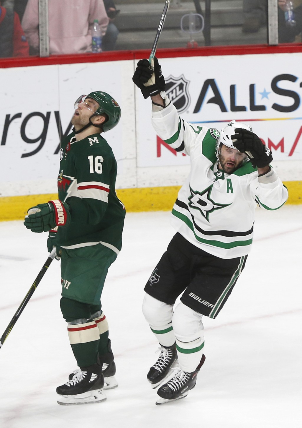 Dallas Stars' Alexander Radulov, right, of Russia, celebrates his game-winning goal in overtime as Minnesota Wild's Jason Zucker reacts in an NHL hock...