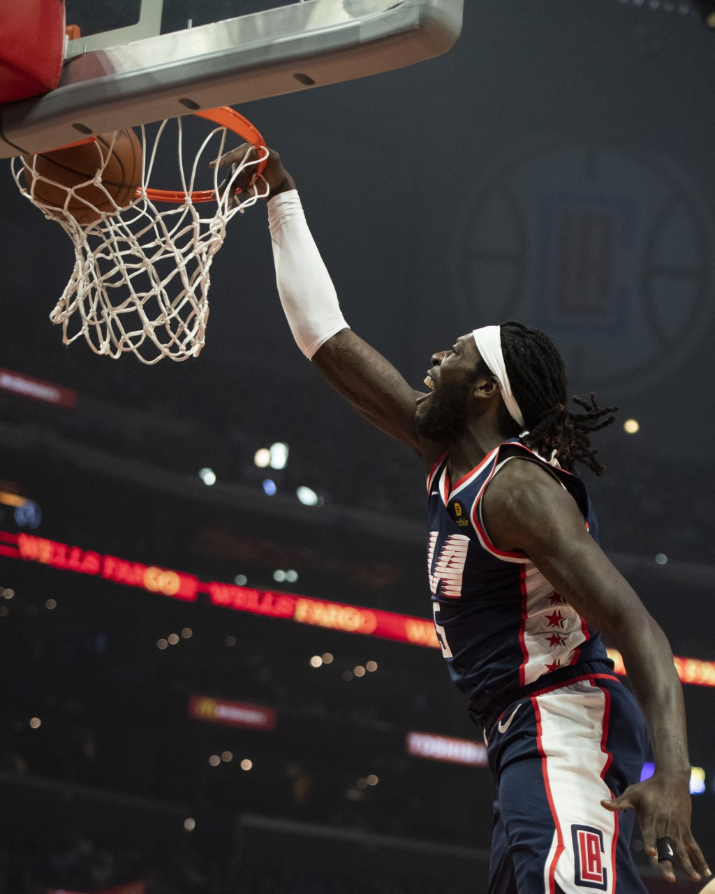 Los Angeles Clippers forward Montrezl Harrell slams a dunk during the first half of an NBA basketball game against the Denver Nuggets in Los Angeles S...