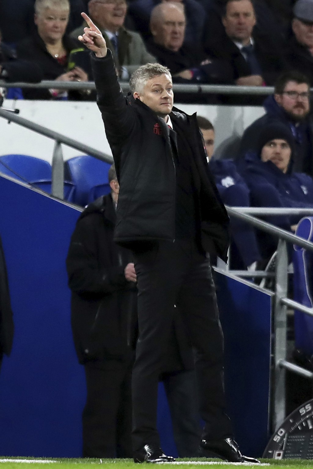 Manchester United manager Ole Gunnar Solskjaer gives instructions to his players during the English Premier League match between Cardiff City and Manc...