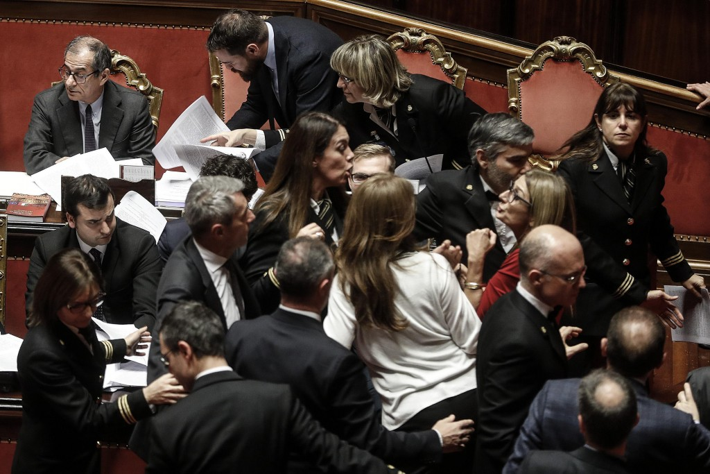 Democratic Party senators protest during the confidence vote on the budget law in the Senate of the Republic in Rome on Satuday, Dec. 22, 2018. Italy'