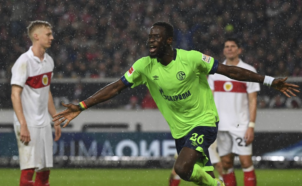 Schalke's Salif Sane, front, celebrates during the German Bundesliga soccer match between VfB Stuttgart and FC Schalke 04 in Stuttgart, Germany, Satur