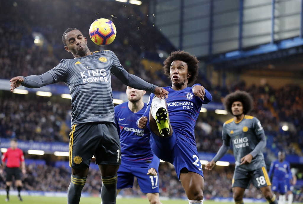 Chelsea's Willian, center, and Leicester's Ricardo, left, challenge for the ball during the English Premier League soccer match between Chelsea and Le...